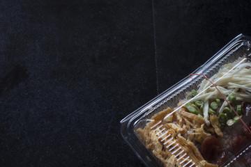 Obraz Rice Mixed with Shrimp paste in plastic box on tile black color. - fototapety do salonu