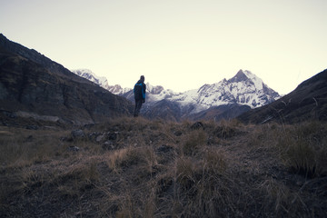 Man standing and looking at view of the mountains
