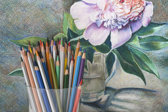 A bunch of colored pencils on the background of a drawing with colored pencils