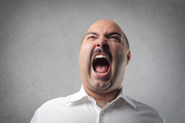 Angry man screaming
