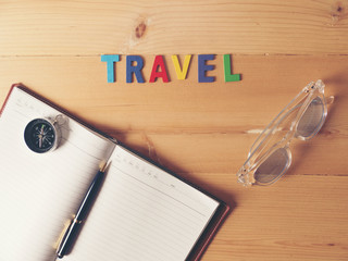 Accessories for travel, on wooden table.