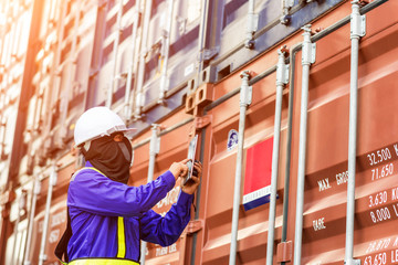 Fototapete - Foreman control loading Containers box from Cargo freight ship for import export.