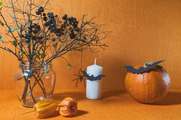 Halloween home decorations on orange background. Still life. Shallow depth of field. Toned.