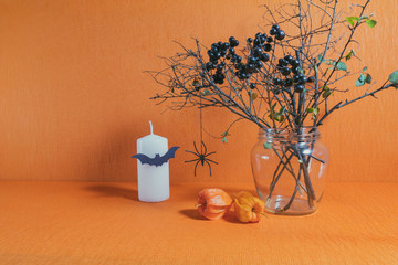 Halloween home decorations on orange background