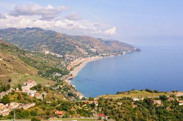View of the coast of the Ionian Sea and the bay of Giardini Naxos from Teatro Greco - Taormina, Sicily, Italy