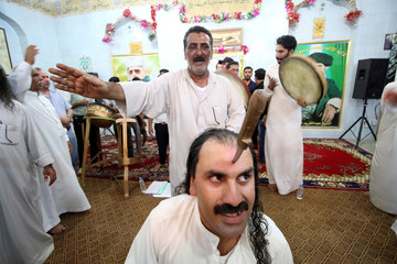 Iraqi Dervish has his forehead pierced with a knife during a religious ritual to mark the holy month of Ramadan at their Tekiyah, a place of worship, in Basra