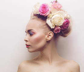 Young woman with flowers on her head