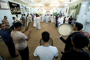 Iraqi Dervishes pray during a religious ritual to mark the holy month of Ramadan at their Tekiyah, a place of worship, in Basra