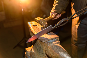 Forging molten metal. Making knives.