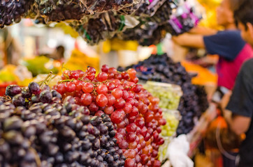 Variety of fresh grape in market.selective focus shot