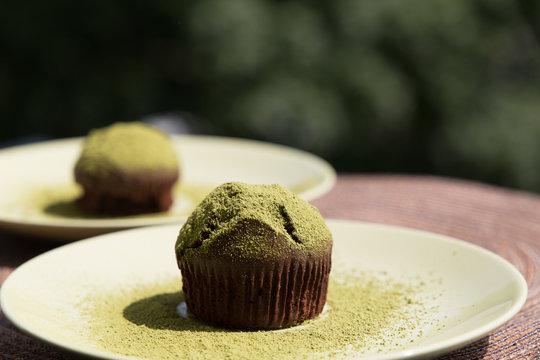 Homemade chocolate sweet muffin with matcha tea topping dessert cake macro close-up browny