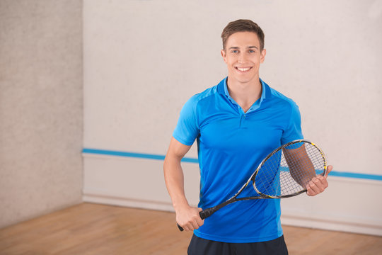 Young man squash player exercise game in the gym