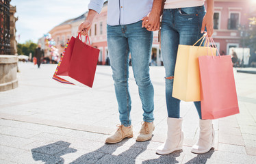 Shopping time. Young couple in shopping. Consumerism, fashion, lifestyle concept