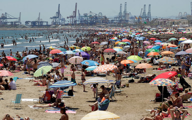 People enjoy the sunny weather at the Malvarrosa beach during the warmest weekend of the year so far, with temperatures over 30 degrees Celsius, in Valencia