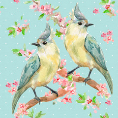 cute seamless texture with lovely birds on flowering twigs. wate