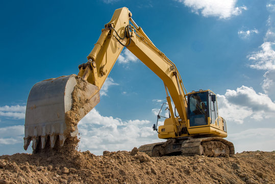 excavator blue sky heavy machine construction site