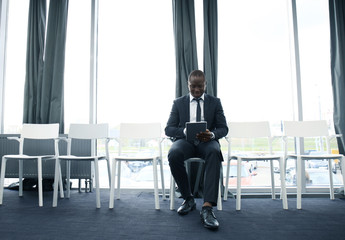 Young man waiting for job interview indoors.