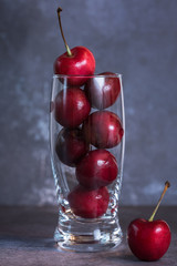 Cherries stacked in a glass