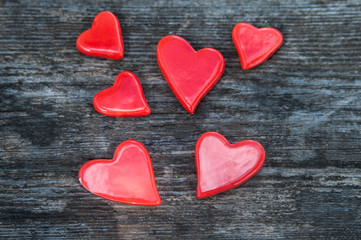 A lot of red hearts on a wooden background. Love Background