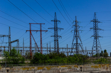 High voltage power lines and towers against sky