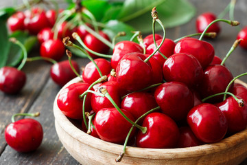 Fresh cherry in a wooden bowl