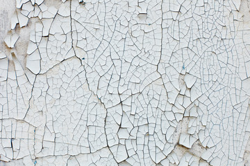 Old wall with white peeling paint. Grunge background