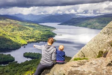 Mom and Boy watching Loch Katrine, Trossachs, Scotland