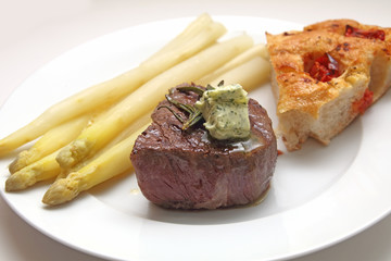 Beef fillet with asparagus and focaccia with tomatoes