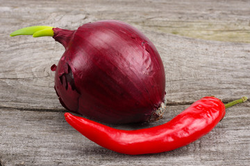 spices, onion, garlic and chili pepper on old wood background
