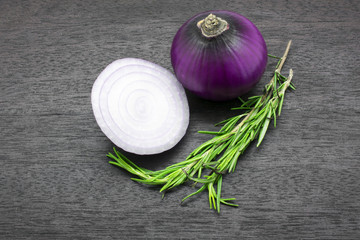 Onions and Rosemary on a Cutting Board