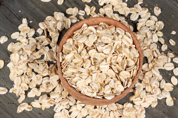 oatmeal in wooden bowl on wooden background top view with copy space