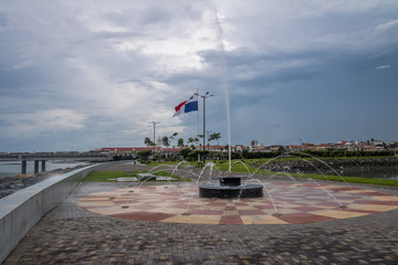 Fountain in Panama City with country flag and Casco Viejo (Old City) on background - Panama City, Panama