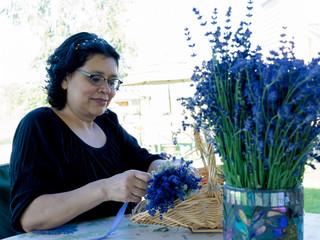 Hispanic Woman Creating Lavender Flower Bouquet