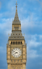 Close up of the clock face of Big Ben in Westminster, London on a cloudy day.