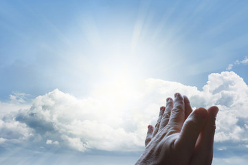 Prayer hands in sky