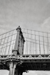 Black and white close up picture of Manhattan Bridge, New York City, USA.