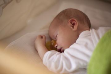 Newborn baby sleeping with nipple