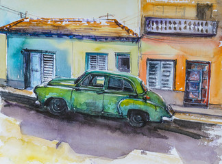 Green car on the front of colorful  houses.Picture created with watercolors.