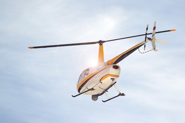 Small turbine helicopter in flight with camera and FLIR equipment