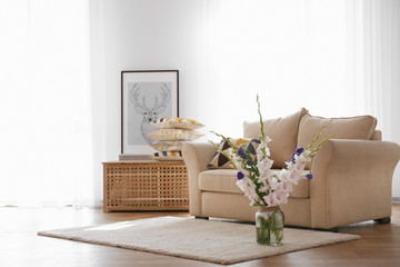 Living room interior with sofa and flowers