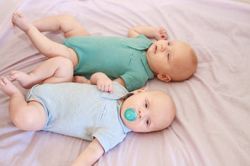 indoor portrait of two young baby twins at home