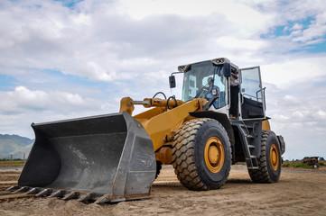 landscape photo of wheel loader in construction site