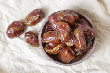 Dried dates in small bowl