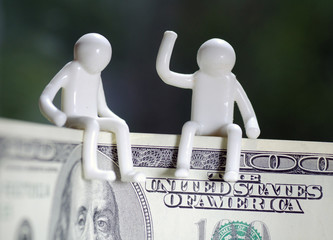 People Sitting On Money Concept