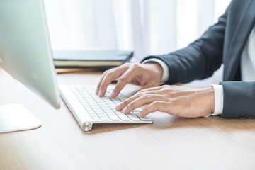 Close-up hand of businessman using computer