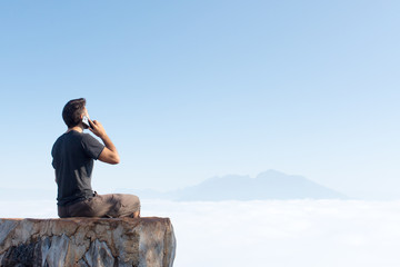 Man in travel in the mountains use mobile phone
