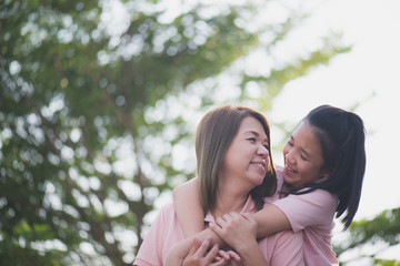 Asian mother and daughter in happines at the outside