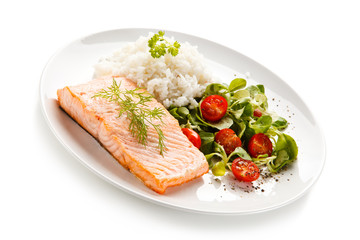 Roast salmon with white rice on white background