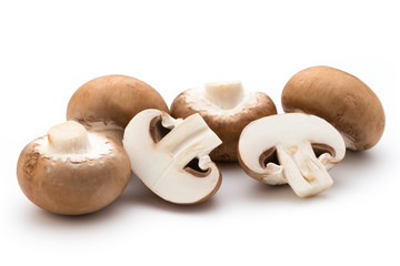Fresh champignon mushrooms isolated on white.