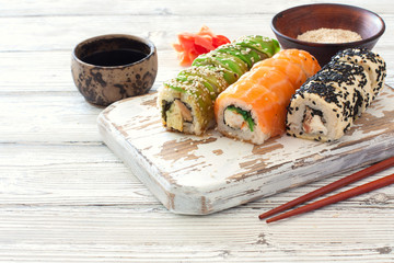 Set of sushi served on a old cuting board